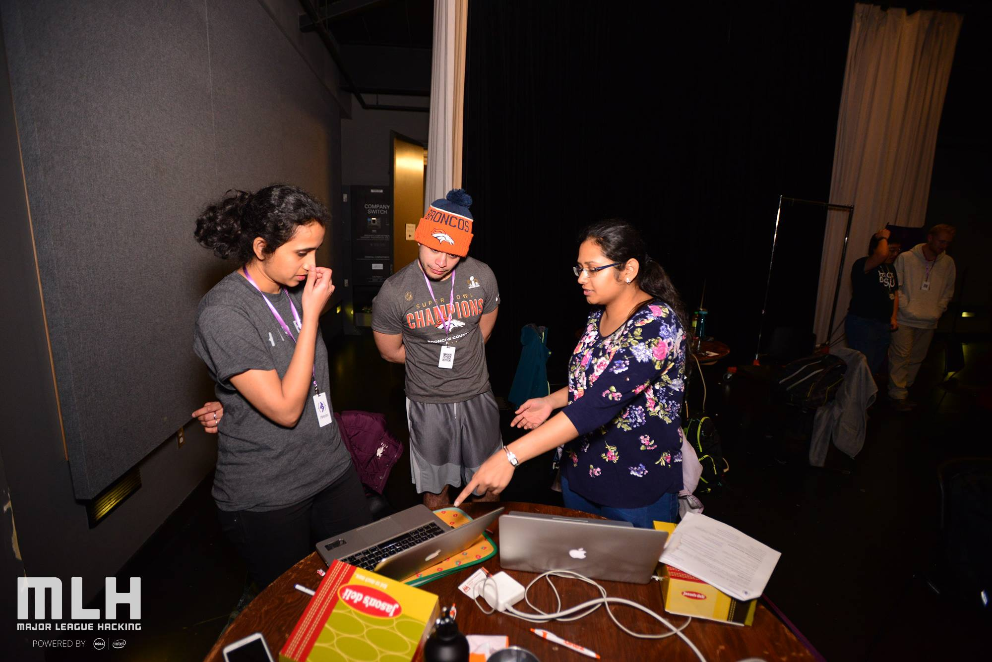 Photos of T9Hackers demoing their projects.